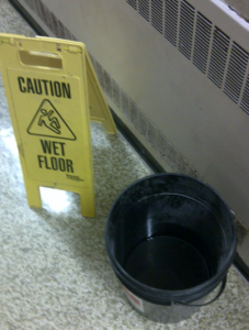 bucket w/caution sign