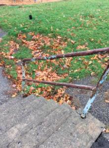 rickety rusty hand railing
